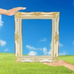 Hands Holding Frame by Anusorn P nachol